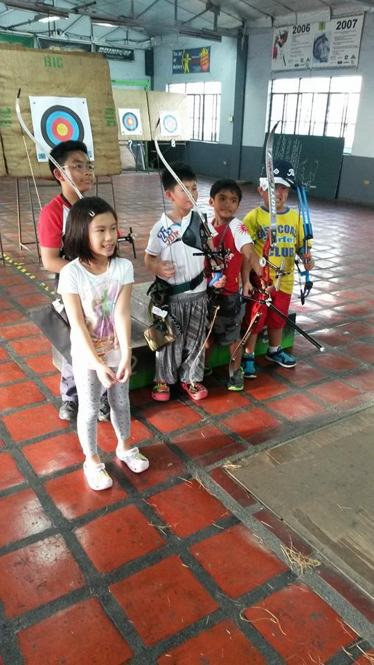 Kids learning archery in Benel Archery in Mandaluyong. Buy a Human Gift certificate at Gifted.PH online for anyone in Manila Philippines