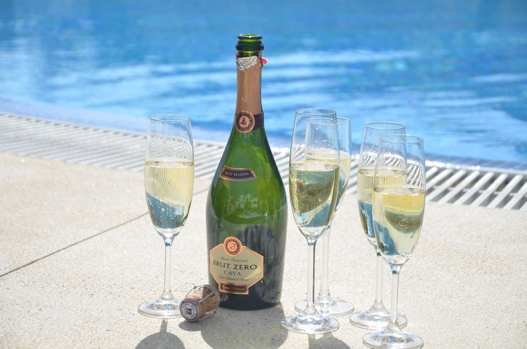 Champagne celebration by the swimming pool
