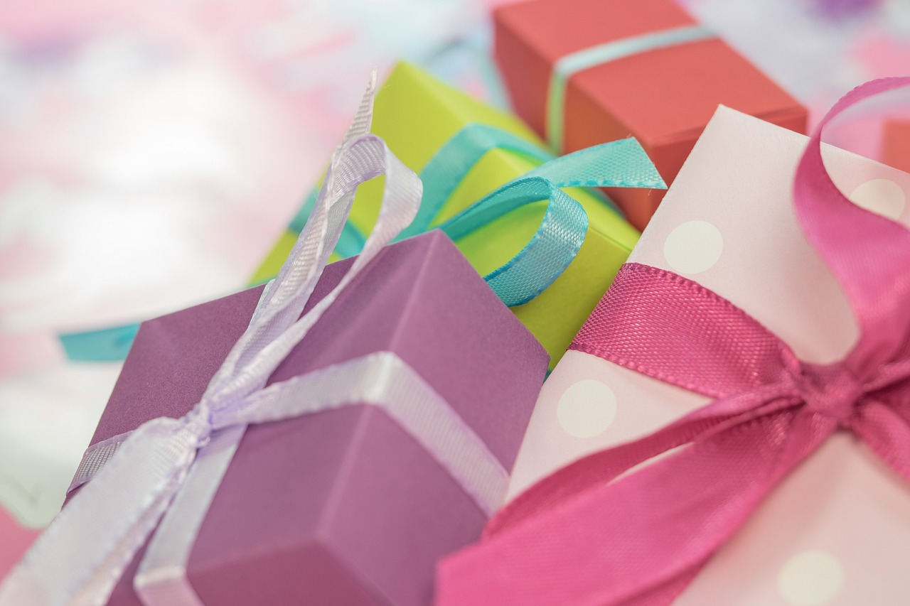 Three Colorful gift boxes in polka dot pink, purple and green