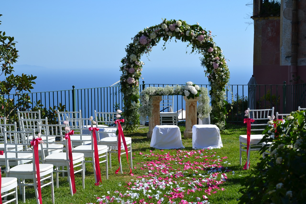 Outdoor wedding with white tiffany chairs and blue skies