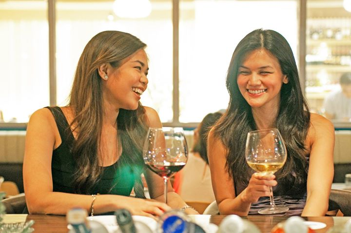 Friends enjoying food and wine at Stella Wood Fire Bistro. Buy Stella Gift Certificates and Gift Cards at Gifted.PH online for anyone in Manila Philippines